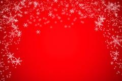 Kerstmisachtergrond van de onduidelijk beeldsneeuw bokeh Royalty-vrije Stock Foto's
