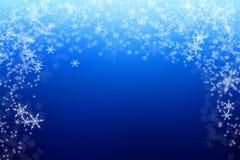 Kerstmisachtergrond van de onduidelijk beeldsneeuw bokeh Royalty-vrije Stock Afbeelding