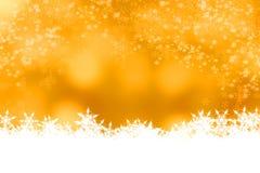 Kerstmisachtergrond van de onduidelijk beeldsneeuw bokeh Stock Afbeeldingen