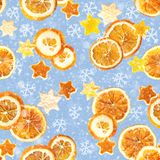 Kerstmisachtergrond van droge sinaasappelen, schil in de vorm van een ster en met kaneel Naadloze Achtergrond royalty-vrije illustratie