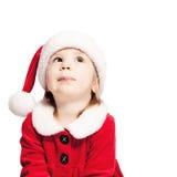 Kerstmisbaby in Santa Hat Looking Up stock afbeeldingen