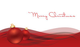 Kerstmisbol op grijze achtergrond met sneeuw Royalty-vrije Stock Foto's
