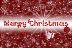 Kerstmisbol op grijze achtergrond met sneeuw Royalty-vrije Stock Afbeeldingen