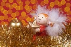 Kerstmisdecoratie, Engel en gloed van licht royalty-vrije stock afbeelding