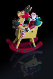 Kerstmisdecoratie: Geïsoleerde het Schommelen Kerstman op Zijn Rendier en Royalty-vrije Stock Fotografie