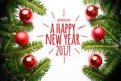 Kerstmisdecoratie met de groet ` die u een gelukkig nieuw jaar 2017 wensen! ` Royalty-vrije Stock Afbeeldingen