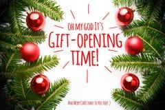 Kerstmisdecoratie met het bericht ` Oh mijn God het de gift-openende tijd van ` s! ` Stock Fotografie