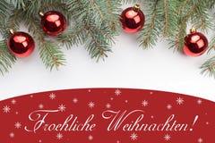 Kerstmisdecoratie met Kerstmisgroet in Duitse ` Froehliche Weihnachten! ` Stock Afbeeldingen