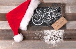 Kerstmisdecoratie met plaats voor groet op krijtbord Royalty-vrije Stock Afbeelding