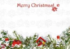 Kerstmisdecoratie op een witte weefselachtergrond Ca van de groet Stock Foto's