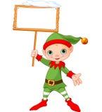Kerstmiself met teken Stock Fotografie
