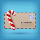 Kerstmisenvelop en zoet suikergoed Stock Foto's