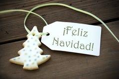 Kerstmisetiket met Feliz Navidad Stock Foto