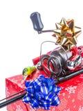 Kerstmisgift in doos voor vissers stock afbeelding