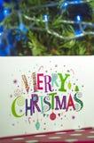 Kerstmisgiften en woorden Vrolijke Kerstmis Royalty-vrije Stock Fotografie