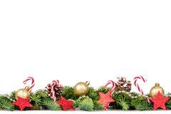 Kerstmisgrens - boomtakken met gouden ballen, suikergoed en decoratie Royalty-vrije Stock Foto