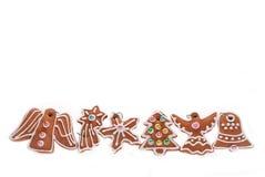 Kerstmisgrens met peperkoekkoekjes die op wit wordt geïsoleerd Royalty-vrije Stock Foto