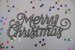Kerstmisgroet in zilveren kleur stock afbeeldingen