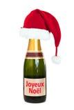 Kerstmishoed op een Champagne-fles Joyeux Noel (vrolijke die Kerstmis), op wit wordt geïsoleerd Royalty-vrije Stock Fotografie