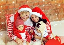 Kerstmisjonge geitjes en moeders royalty-vrije stock foto