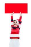 Kerstmisjongen met lege banner Stock Foto's