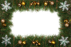 Kerstmiskader van spartakken wordt gemaakt met ballen worden en sneeuwvlokken op witte achtergrond worden geïsoleerd verfraaid di Stock Fotografie