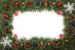 Kerstmiskader van spartakken wordt gemaakt met klokken en ballen worden op witte achtergrond worden geïsoleerd verfraaid die Royalty-vrije Stock Foto