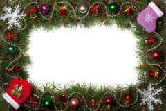 Kerstmiskader van spartakken wordt met klokken en ballen op witte achtergrond worden verfraaid gemaakt die Stock Foto