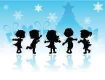 Kerstmiskinderen van silhouetten Royalty-vrije Stock Foto