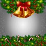 Kerstmisklokken en suikergoedriet Stock Foto
