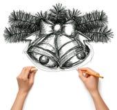 Kerstmisklokken van de schets met menselijke handen royalty-vrije stock foto's