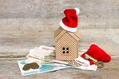 Kerstmiskorting op huis Stock Foto's