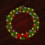 Kerstmiskroon met lichte slinger en zijdeboog Royalty-vrije Stock Afbeeldingen