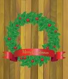 Kerstmiskroon van hulst op een houten achtergrond Royalty-vrije Stock Afbeelding