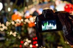 Kerstmislichten op camera royalty-vrije stock afbeeldingen