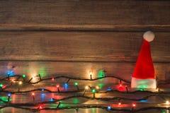 Kerstmislichten op de houten achtergrond De ruimte van het exemplaar Royalty-vrije Stock Afbeeldingen