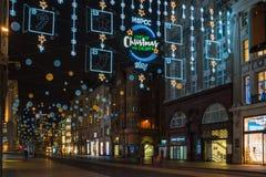 Kerstmislichten op de Straat van Oxford, Londen, het UK Stock Afbeelding