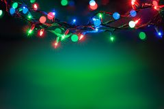 Kerstmislichten over zwarte achtergrond Royalty-vrije Stock Fotografie