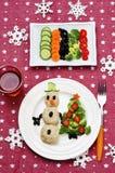 Kerstmislunch met gezonde kid& x27; s voedsel royalty-vrije stock afbeeldingen