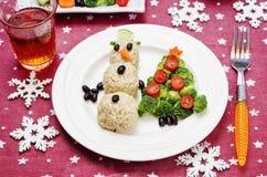Kerstmislunch met gezonde kid& x27; s voedsel royalty-vrije stock afbeelding