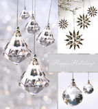 Kerstmisornamenten van het kristal tegen zilver Stock Foto's