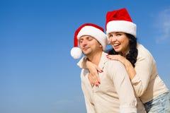 Kerstmispaar op een strand Stock Afbeeldingen