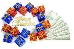Kerstmispakketten met dollar Stock Foto's