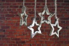 Kerstmisslinger van houten ster Stock Afbeelding