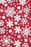 Kerstmissneeuwvlok en Snuisterijachtergrond royalty-vrije stock afbeelding