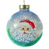 Kerstmisspeelgoed, blauwe bal met een patroon van Santa Claus stock afbeeldingen