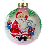 Kerstmisspeelgoed, roze bal met een patroon van Santa Claus stock foto's