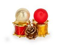 Kerstmisspeelgoed twee trommels, twee ballen en buil Royalty-vrije Stock Fotografie