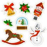 Kerstmisstickers op witte achtergrond worden geplaatst die Royalty-vrije Stock Foto's