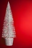 Kerstmisstuk speelgoed beeldje op rood stock foto